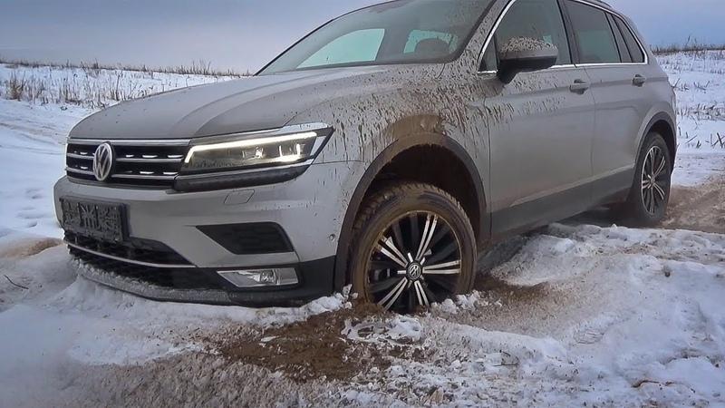 Volkswagen Tiguan зимой на проселочной дороге