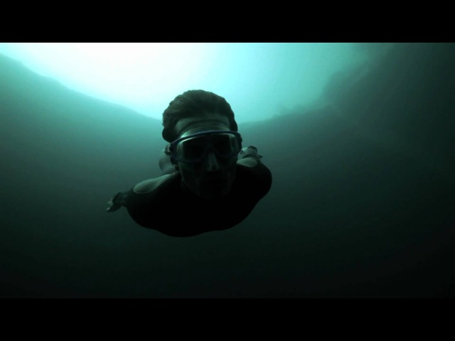 Guillaume Nery base jumping at Dean's Blue Hole filmed on breath hold by Julie Gautier