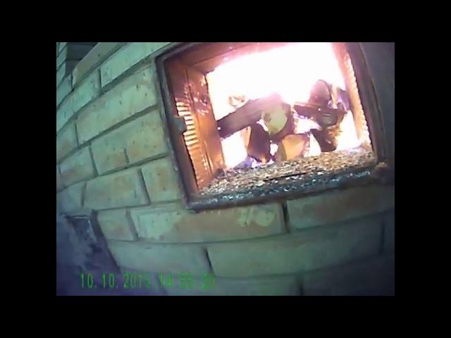 Активное горение,и догорание газов в колодце печи .