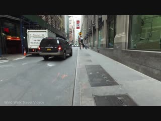 Walking from world trade center to wall street in downtown manhattan, new york city