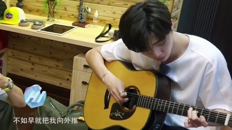 Nongnong playing guitar