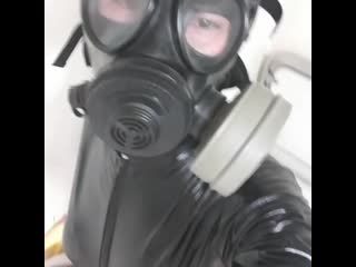 Latex catsuit gas mask in filtr