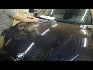 BMW X5 снятие с капота старой антиграв плнки