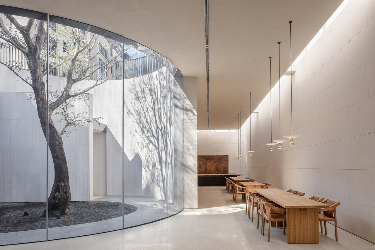 Waterfrom Design builds tea house with a basement hidden beneath a water pool